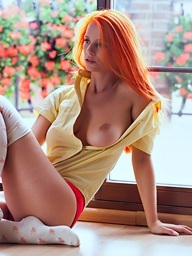, A redhead cutie exposes..
